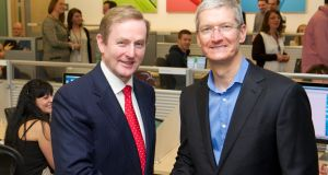 Tim Cook, Apple's CEO and Taoiseach Enda Kenny meet at at  Apple's campus in Cork, Ireland in  2014. The EU Commission is preparing to issue a final ruling that Ireland's tax deal with Apple represented illegal state aid.