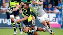 Leinster's Cian Healy makes a pass despite being being tackled. Photograph: Tommy Dickson/Inpho