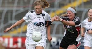 Kildare's Maria Moolick in action against and Ruth Goodwin of Sligo during the TG4 Ladies Intermediate All-Ireland Football  semi-final at Kingspan Breffni Park. Photograph:   Lorraine O'Sullivan/Inpho