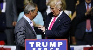 Republican presidential nominee Donald Trump, right, greets Ukip leader Nigel Farage during a campaign rally in Mississippi last week. Photograph: Getty