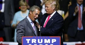 Republican presidential nominee Donald Trump, right, greets UK Independence Party leader Nigel Farage during a campaign rally at the Mississippi Coliseum  in Jackson, Mississippi, last week. Photograph: Getty