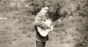 Louis Stewart with his first guitar, bought from Waltons on Camden Street, at the age of 14.