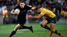 New Zealand's Ben Smith  is tackled by Australia's Quade Cooper during the Rugby Championship match at Westpac Stadium in Wellington. Photograph: Marty Melville/AFP/Getty Images