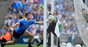 David Byrne and goalkeeper Stephen Cluxton fail to prevent Paul Geaney's effort from going over the line for  Kerry's second goal. Photograph: Donall Farmer/Inpho