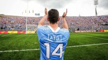 Dermot Connolly, who slotted the insurance score for Dublin, celebrates before the Hill 16 faithful at the end of a gripping semi-final at  Croke Park. Photograph: Ryan Byrne/Inpho