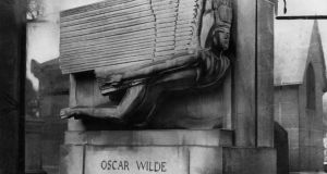 September 1961: The tomb of the Irish author and playwright Oscar Wilde designed by Sir Jacob Epstein, in Père Lachaise cemetery in Paris. Photograph: Express/Express/Getty Images