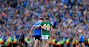 Titanic struggle: Dean Rock of Dublin commiserates with  Marc Ó Sé of Kerry after the All-Ireland SFC semi-final on Sunday, which Dublin won by 0-22 to 2-14. Photograph: Donall Farmer/Inpho