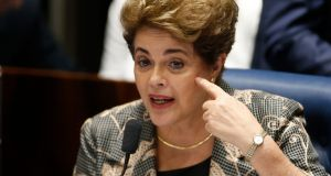 President Dilma Rousseff testifies on the Senate floor during her impeachment trial  in Brasilia, Brasil. Senators will vote in the coming days whether to impeach and permanently remove her from office. Photograph: Igo Estrela/Getty Images