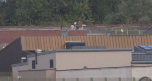 Residents on the roof at the Oberstown Detention Campus in  Dublin. Photograph:  Gareth Chaney Collins