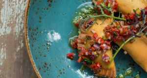 Chickpea empanadillas, piquillo pepper salsa and lovage oil