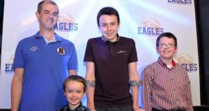 Alan Hawe with his sons Ryan (6), Liam(13) and Niall (11) at an East Cavan Eagles basketball game in May of this year.