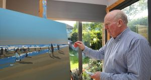 Artist John Morris paints in his cedarwood studio in his Mount Merrion home