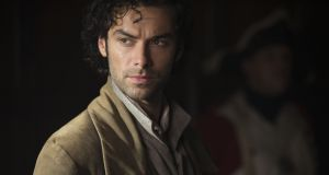 Aidan Turner: ignores social media, although his hair has its own Twitter account and his shirtless scything scene caused an explosion