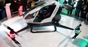 Ehang's single-seater autonomous minicopter prototype: the passenger straps in, touches in a destination, and the machine does the rest. Photograph: AP Photo/John Locher