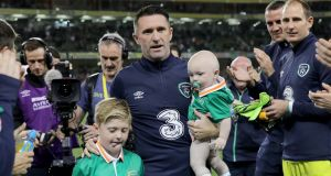 Robbie Keane and  his sons Robert and Hudson are applauded off the pitch by team-mates at the end of the game.  Photograph: Morgan Treacy/Inpho