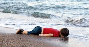 On September 2nd, 2015, the body of three-year-old Syrian refugee Alan Kurdi washed up on a Turkish beach. Alan, his mother, Rehana, and five-year-old brother, Ghalib, drowned together just 4km from the shore while attempting to cross the Mediterranean to seek refuge in Europe Photograph: Demir/AFP/Getty