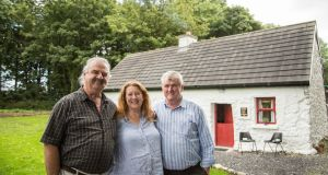 Bob and Pat Cohan with their builder Tim Hughes   at their cottage in Kilcolman, Claremorris, Co Mayo. Photograph: Keith Heneghan/Phocus