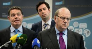 Ping-pong: Minister of State for Financial Services – behind Minister for Finance Michael Noonan and Minister for Public Expenditure Paschal Donohoe – has the kind of charged argument that Matt Cooper revels in. Photograph: Dara Mac Dónaill