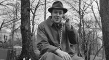 "Roald Dahl answers a telephone while filming an episode of the science fiction show ""Way Out"" in Central Park, New York, March 25, 1961. Photograph:  CBS Photo Archive/Getty Image"