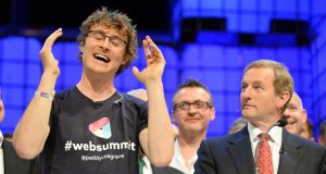 Watching you: Paddy Cosgrave, with Taoiseach Enda Kenny at the 2014 Web Summit in Dublin. Photograph: Eric Luke / The Irish Times