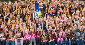 Mairéad Frisby from Tipperary (centre, in blue and gold), a special needs assistant at Grennan College in Thomastown, Co Kilkenny, with students in Kilkenny colours ahead of this weekend's All-Ireland Hurling final between Kilkenny and Tipperary. Photograph: Dylan Vaughan