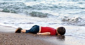 Alan Kurdi's body lying on the shore in Bodrum, southern Turkey, after a boat carrying refugees sank while heading to the Greek island of Kos. Photograph: Nilufer Demir/AFP/Getty Images