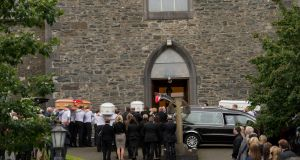 Mourners at the funeral of Alan Hawe (41), his wife Clodagh (39) and their sons Liam (13), Niall (11) and Ryan (6) at St Mary's Church, Castlerahan, Co Cavan. Photograph: Dara Mac Dónaill/The Irish Times