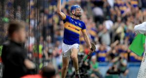 Tipperary's John McGrath celebrates scoring his side's second goal during the All-Ireland Senior Hurling Championship Final clash with Kilkenny. Photo: Donall Farmer/Inpho