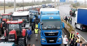 Hauliers, farmers and harbour workers, among others, mount a protest blockade  over the migrant situation in Calais, France, September 5th, 2016.  Photograph: Charles Platiau/Reuters