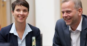 Frauke Petry, chairwoman of AfD, with party candidate Lief-Erik Holm: said the coalition partners were damaging themselves by refusing to listen to the public. Photograph: Wolfgang Kumm/EPA