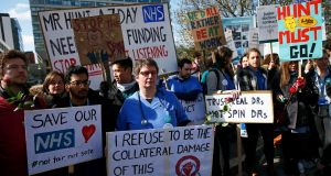 Junior doctors and supporters hold placards during a strike outside St Thomas's Hospital in London, in April. Photograph: Stefan Wermuth/Reuters