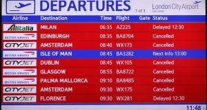 An information screen lists cancelled and delayed flights at City Airport after a protest closed the runway in London. Photograph: Reuters