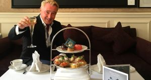Michael Flatley with an array of sandwiches and pâtisserie inspired by his artwork