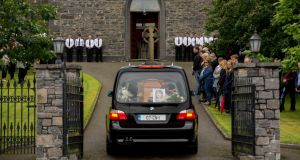 The remains of Clodagh Hawe being brought to the joint funeral with her husband, Alan, and their sons, Liam (13), Niall (11) and Ryan (6), at St Mary's Church, Castlerahan,  Co Cavan. Photograph: Dara Mac Dónaill