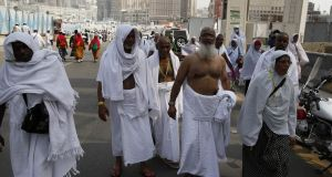 Muslim pilgrims walk in the streets of Saudi Arabia's holy city of Mecca on Tuesday. Photograph:  Ahmad Gharabli/AFP/Getty Images