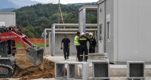Workers build a new school in Amatrice, Italy. Photograph: Alessandro Di Meo/EPA