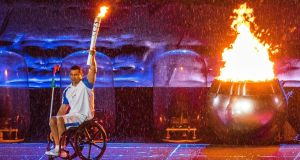 Brazilian Paralympic swimmer Clodoaldo Silva lights the cauldron during the opening ceremony of the Rio 2016 Paralympics Games at the Maracana Stadium in Rio de Janeiro, Brazil. Photograph: EPA/Jens Buttner