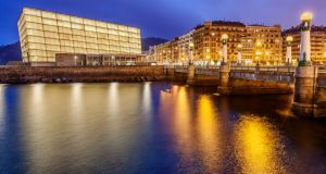 Puente del Kursaal (bridge) over the river Urumea, with the Kursaal congress centre and auditorium lit in the background. Photograph: Getty Images