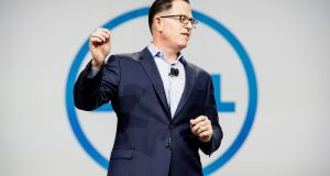 Michael Dell, founder and chief executive officer of Dell. The firm, which completed the acquisition of data storage company EMC Corp on Wednesday, will cut 2,000-3,000 jobs, Bloomberg reported