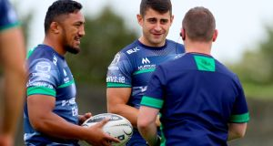 Connacht's Bundee Aki and Tiernan O'Halloran during training ahead of their Pro12 meeting with Ospreys. Photo: James Crombie/Inpho