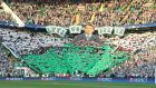 Celtic fans unveil a large picture of manager Brendan Rodgers during the Uefa Champions League qualifying play-off first leg against Hapoel Be'er Sheva at Celtic Park in August. Photograph: Steve Welsh/Getty Images