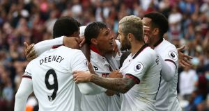 Watford midfielder José Holebas (centre) celebrates scoring his team's fourth goal during the  Premier League match against West Ham  at The London Stadium. Photograph:   Justin Tallis/AFP/Getty Images