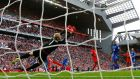Leicester goalkeeper Kasper Schmeichel watches Adam Lallana's shot go by him as he scored Liverpool's third goal in the Premier League game at Anfield. Photograph: Darren Staples/Reuters/Livepic