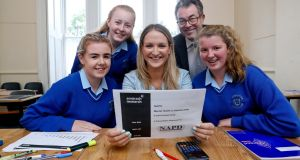 Minister for Mental Health Helen McEntee and Clive Byrne, Director of the NAPD, with 5th year students (from left, Lisa Hamilton, Angelika McDermott and Megan Brodie) in Eureka Girls Secondary school in Kells. Photograph: Maxwells
