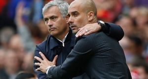 Manchester United manager José Mourinho and Manchester City manager Pep Guardiola at the end of the derby game. Photograph: Reuters