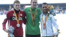 Silver Medalist Liam Stanley of Canada, Gold medalist Michael McKillop of Irlend and Bronze medalist Madjid Djemai of Algeria celebrate on the podium at the medal ceremony for the Men's 1500 metre T37 Final during day 4 of the Rio 2016 Paralympic Games at the Olympic Stadium in Rio de Janeiro, Brazil. Photo: Alexandre Loureiro/Getty Images