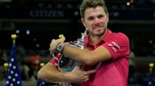 Stan Wawrinka of Switzerland celebrates with the trophy after winning 6-7, 6-4, 7-5, 6-3 against Novak Djokovic of Serbia in the US Open final. Photograph: Getty Images