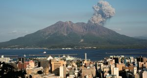 Undated handout photo issued by the University of Exeter of Sakurajima volcano with the city of  Kagoshima in the foreground.  Photograph: Sakurajima Volcano Research Centre/University of Exeter/PA Wire
