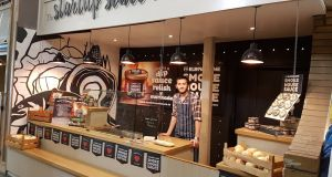 Ciaran Cummings, manager of Elbow Lane Brewery and Smokehouse, at the Start-Up Stall at Cork's English Market, where the makers of Smokehouse Sauce are running a 24days24ways initiative during their guest trader residency