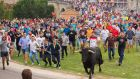 "Festival-goers chase the bull during the rebranded ""Toro de la Pena"" in Tordesillas, Spain, but, unlike previous years, they are no longer allowed to kill it. Photograph: AFP/Getty Images"